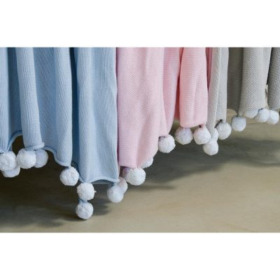 soft cotton baby blanket with pom poms
